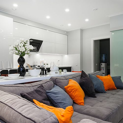 Modern designer white living studio with bedroom doors open